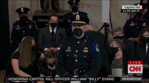 Biden appears to give presidential challenge coin to 9-year-old son of the late U.S. Capitol Police Officer Billy Evans.