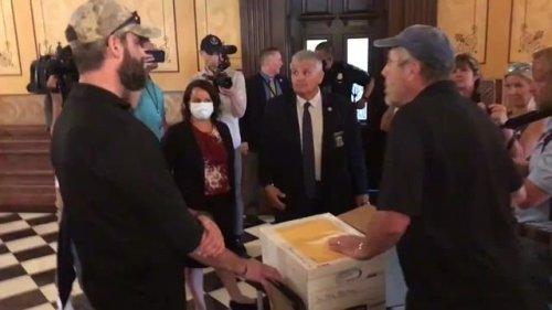 Demonstrators protest MI Senate Leader Shirkey's office because he won't sign affidavits calling for audit of election.