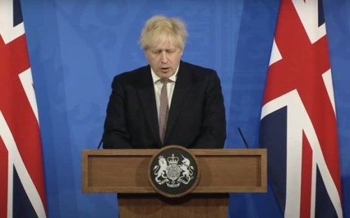 "UK PM Boris Johnson eases COVID restrictions for indoor gathering and mask wearing, but he cautions against ""hugging."""