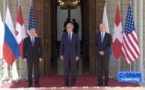 President Biden and President Putin shake hands before their first official summit in Switzerland.