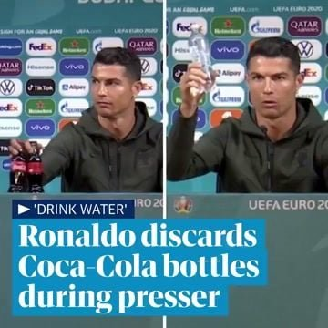 """Drink water!"" — Portuguese star Cristiano Ronaldo removes a couple Coke bottles at his pre-Euro press conference."