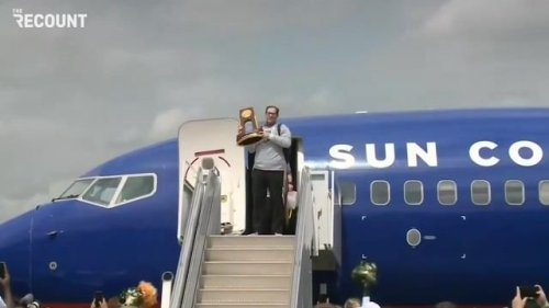 The Baylor Bears, led by head coach Scott Drew, touch down in Texas with their NCAA Championship trophy.