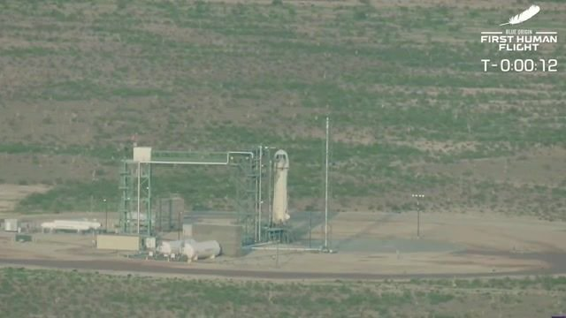 Blue Origin rocket launches for flight to the edge of space with Amazon founder Jeff Bezos and his brother Mark Bezos.