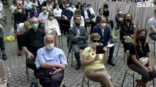 Person dressed as Spider-man sits in VIP section of Pope Francis' general audience.