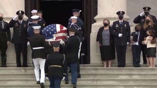 Late U.S. Capitol Police Officer William Evans' casket is carried into the U.S. Capitol where he will lie in honor.