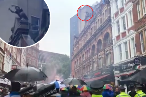 Moment daredevil Scotland fan climbs onto roof of London building as crowd cheer