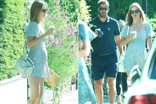 Jamie Redknapp's pregnant girlfriend Frida Andersson snapped clutching baby bump