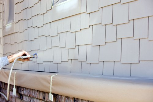 Learn How to Use a Paint Sprayer on Your House Exterior