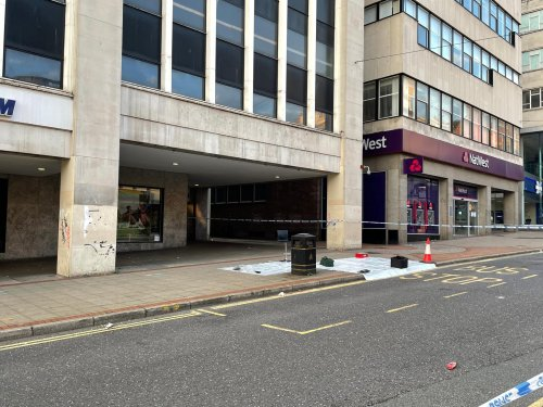 Evidence marker spotted at city centre murder scene as area remains sealed off