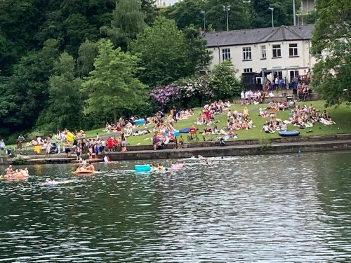 Swimmers pictured in lake at packed Sheffield park despite safety warning