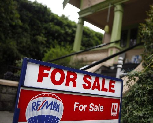 CMHC predicts COVID-19 immunity will moderate pace of home sales, prices by 2023