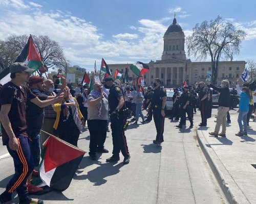 Tensions flare between clashing Israel and Palestine rallies at Manitoba Legislature