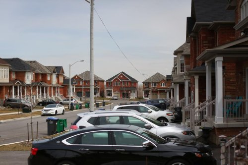 Houses prices in Toronto dropped slightly, while the 905 saw a jump, says the Toronto Regional Real Estate Board