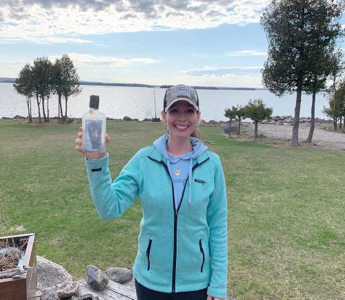 'Dear son in heaven': Message in a bottle pulled from Lake Huron holds photo, cash and Flamborough family's heartbreak