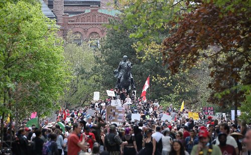 Charges laid at two massive protests in downtown Toronto on Saturday