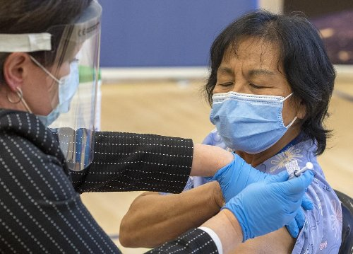 The woman who got the first of Toronto's 3 million COVID-19 vaccinations is trying to boost that number every day