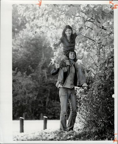 The story behind a 1973 photo of a young couple gathering autumn leaves. Spoiler alert: they're still going strong