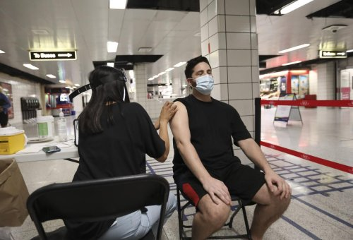 Why I finally got the vaccine: At pop-up clinics, the hesitant say why they decided to roll up their sleeves