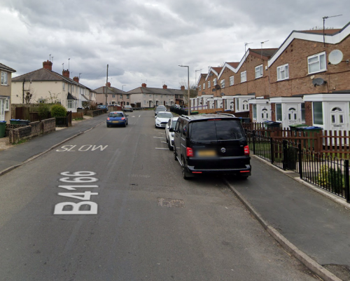 Man killed and woman rushed to hospital after being pulled from burning house
