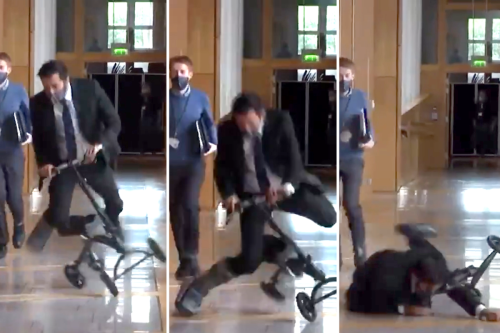 Moment Humza Yousaf falls off scooter while racing through Holyrood