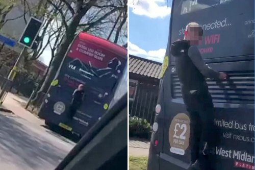 Idiot risks his life by clinging to the back of a bus doing 30mph