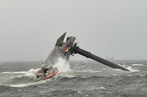 Coast Guard search for 12 people as 129ft ship capsizes in 'microburst' storm
