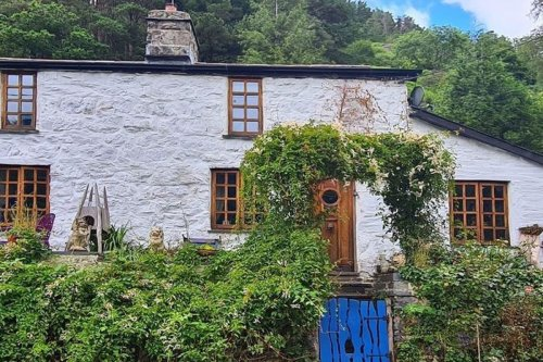 Couple snap up dream cottage after spotting mysterious shape in bedroom