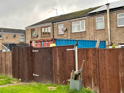 Raging mum lives by 19ft eyesore after neighbour left shipping container on lawn
