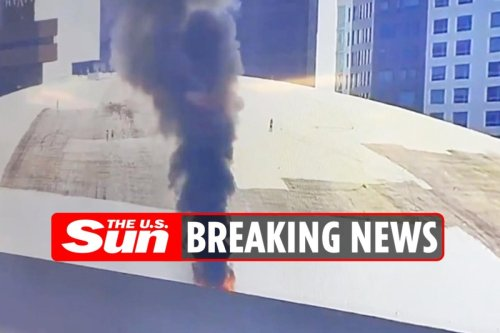 Roof of stadium catches alight as smoke seen billowing from building