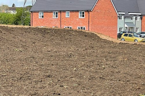 Locals furious as 8ft pile of MUD left next to homes floods their yards