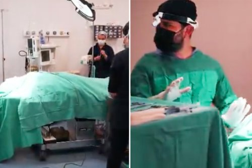 Katie Price seen on operating table as team of surgeons work on her face