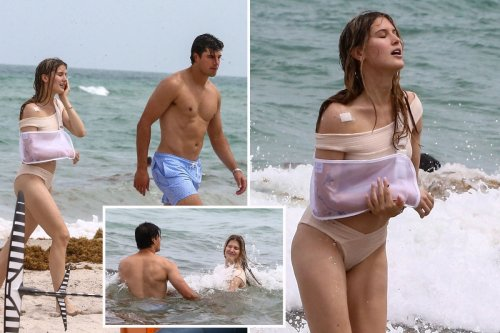 Eugenie Bouchard dips in sea with arm in sling on holiday with NFL ace boyfriend