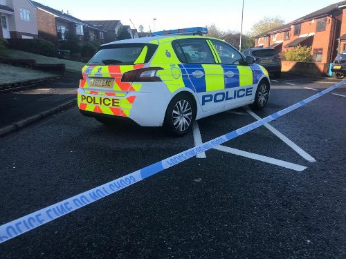 Man, 63, arrested on suspicion of murder after woman dies at home in Oldham