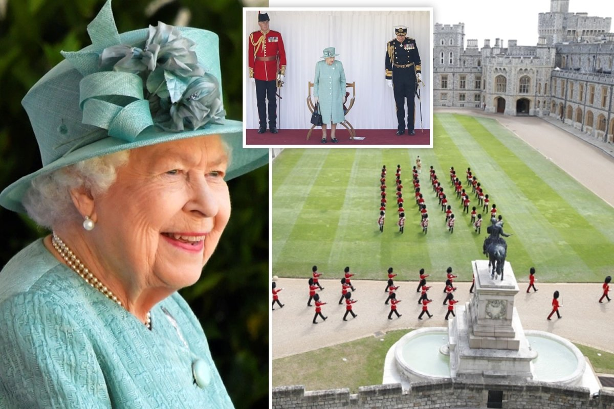Queen smiles as she watches Trooping the Colour ceremony to mark her birthday