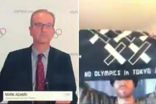 Protester posing as media crashes press call shouting 'f*** the Tokyo Olympics!'