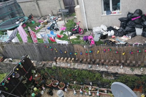 Gran, 51, physically SICK as neighbour mum-of-11's yard filled with rubbish