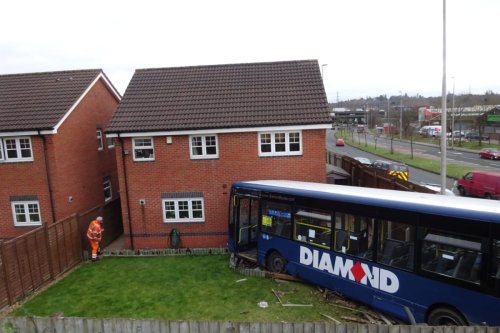 Couple saved by having a lie-in when a bus smashed into their home