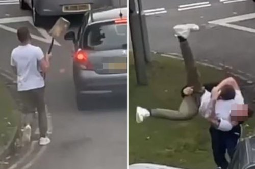 Shocking moment driver chases man with a SPADE and smashes his back window