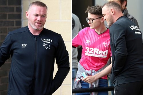 Wayne Rooney laughs off party girl scandal as he poses for pics with fans