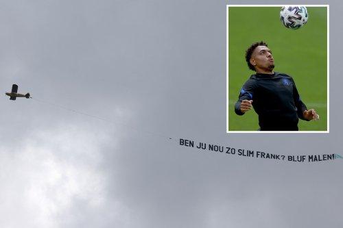 Fans fly banner over Holland training demanding De Boer plays Arsenal flop Malen
