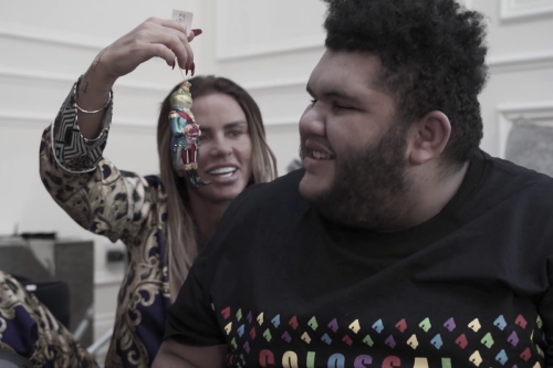 Katie Price's son Harvey beams with delight as she surprises him with frog and train Christmas tree decorations