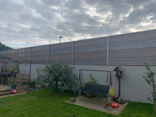 Furious residents blast huge 3.5 metre fence leaving their homes 'like prisons'