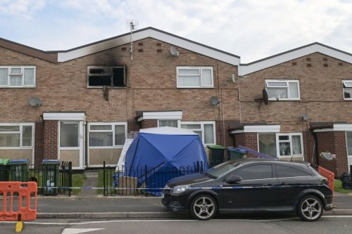Teen girl, 18, arrested as man killed and woman hurt in horror house fire