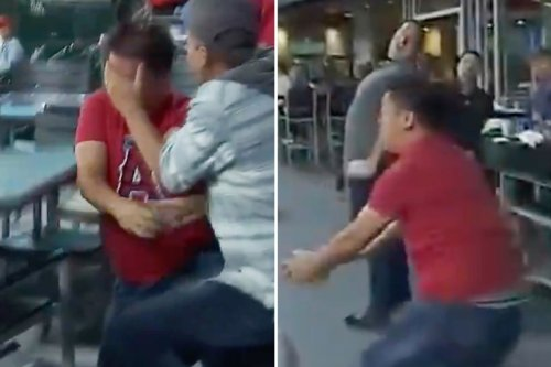 Angels fan smashed in THROAT and crashes into table in wild foul ball vid