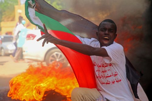 Sudan in 'state of emergency' as 'complete coup' underway amid violent protests