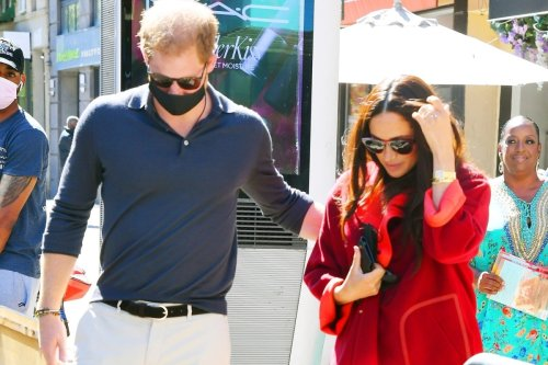 Meghan arrives at school where 94% get free meals, whilst wearing £5.5K suit