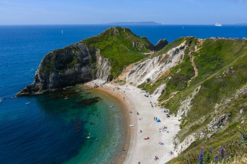 Woman dies falling from cliffs in front of beach goers at Durdle Door