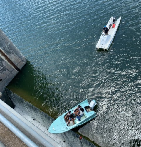Shock pic shows boat full of revelers perched on the edge of 36ft drop