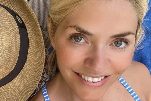 Holly Willoughby in a bikini as she soaks up the sun while working on her book
