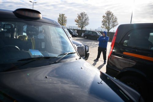 Black cab driver found dead in his taxi while waiting for a fare at Heathrow
